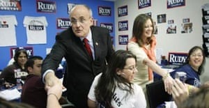 Rudy Giuliani, with his wife Judith Nathan, thanks volunteers at his campaign headquarters in Winter Park, Florida. Photograph: Gerald Herbert/AP