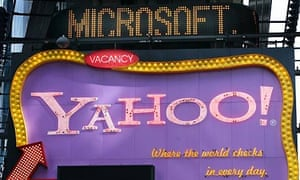 A headline about Microsoft above a billboard for Yahoo
