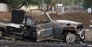 The wreckage of a burnt-out car in a street of N'Djamena, Chad