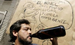 A man drinks a beer in Mexico City