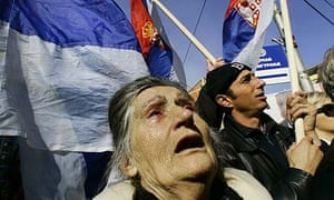 A Kosovo Serb woman cries as she attends a rally against the independence of Kosovo in the town of Mitrovica, Kosovo