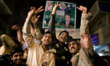 Supporters of Pakistan's former prime minister Nawaz Sharif celebrate early results in Pakistan's general elections in Lahore