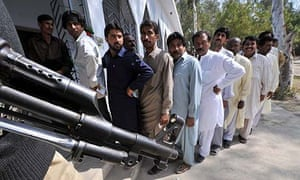 Voters wait to cast their ballots at a polling station in Nawabshah, some 200 Kms northeast of Karachi, Pakistan