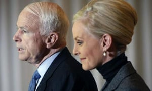 John McCain and his wife Cindy, speaks at a news conference in Toledo, Ohio. Photograph: Gerald Herbert/AP