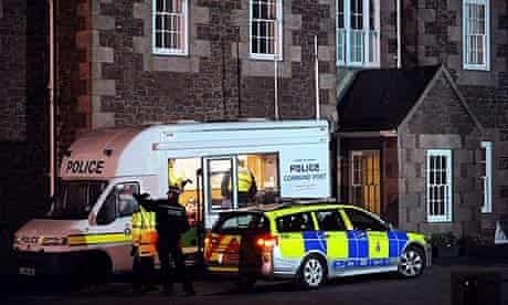 Police officers work on the investigation at the Haut de la Garenne Youth Hostel near St. Martin in Jersey