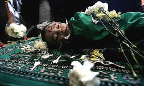 The body of six-month old Mohammad al-Buri lies at the mosque during his funeral in Gaza City.