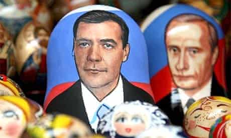 Matrioshka dolls with the faces of Dmitry Medvedev and Vladimir Putin on the table of a street vendor in St Petersburg