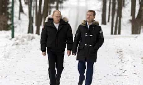 Vladimir Putin and Dmitry Medvedev take a stroll in Moscow