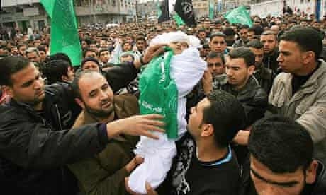 Palestinians in Jabalia refugee camp in Gaza carry the body of a 21-month-old girl killed in an Israeli airstrike