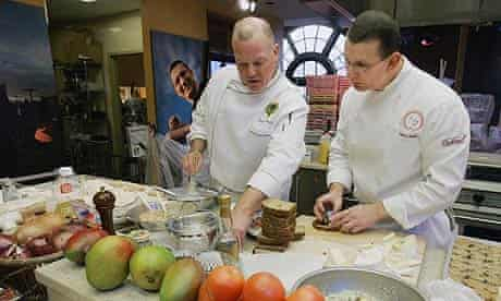 Chef Robert Irvine, right, of the Food Network's show Dinner: Impossible, and one of his sous chefs work in one of the network's kitchens in New York