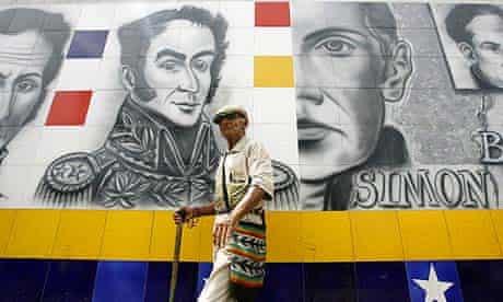 A man walks past Simon Bolivar international bridge at the border connecting Colombia with Venezuela