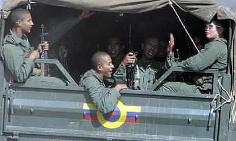 Venezuelan soldiers ride in a military truck towards the Colombian border as their leave their base.