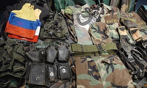 Uniforms and materials seized from the Colombian Revolutionary Armed Forces (FARC) displayed at a press conference in Quito, Ecuador.