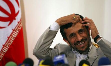 Iranian President Mahmoud Ahmadinejad smiles during a press conference at Tehran's Mehrabad airport