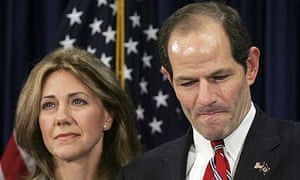 New York governor Eliot Spitzer addresses the media with his wife Silda Wall Spitzer at his office in New York