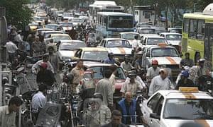 Traffic builds up on Tehran's Poonzayeh-Khordad street
