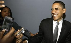 Barack Obama shares a joke with his supporters at a campaign stop at Jackson State University in Jackson, Mississippi