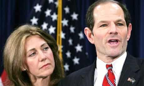New York Governor Eliot Spitzer addresses the media with his wife Silda Wall Spitzer at his side