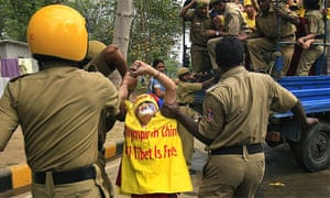 New Delhi police officers arrest female activists during a pro-Tibet demonstration outside the Chinese embassy in the Indian capital