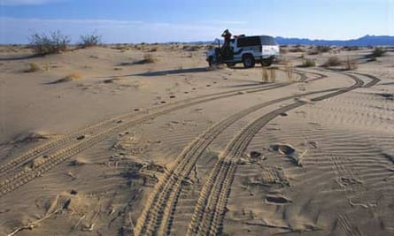 Border patrol agent in the Arizona desert. Photograph: George Steinmetz/Corbis