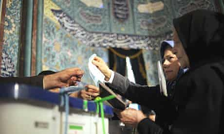 Iranian women cast their votes in the country's parliamentary election at a polling station in Tehran