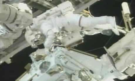 Mission specialist Rick Linnehan works on the Canadian robot, named Dextre.