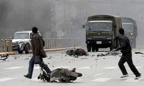 Tibetans throw stones at Chinese army vehicles in Lhasa as violent protests against Chinese rule break out