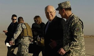 US vice-president Dick Cheney, centre, talks to Genereal David Petraeus on his arrival at Baghdad's Sather air base