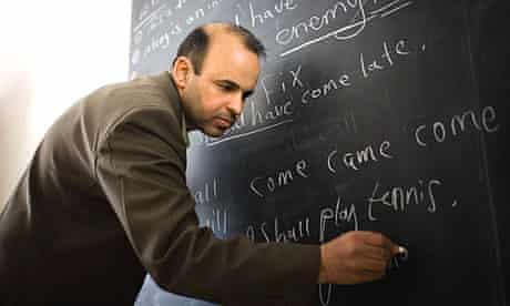 Iraqi English teacher Ali Abdul Zahra teaches his class in a poor Shia neighborhood of Baghdad