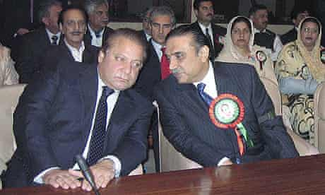 Nawaz Sharif (l) and Asif Ali Zardari (r) during a meeting at Parliament House prior to the national assembly's first session in Islamabad.