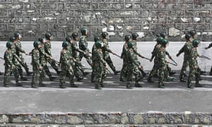 Chinese riot police march through the city of Kangding, Sichuan Province.