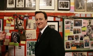 David Cameron looks around the Smiths room at Salford Lads Club