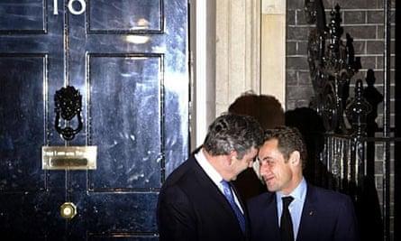 Gordon Brown greets Nicolas Sarkozy.