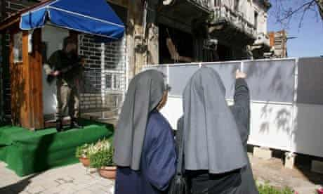 Two nuns look at the changed view of the lower part of Ledra Street in Nicosia, Cyprus