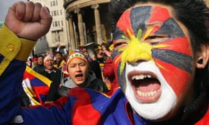 Tibet protestors march outside the Chinese embassy in London