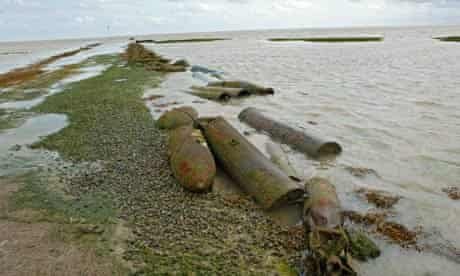 Rusted torpedoes and bombs, munitions on Foulness Island, an MOD weapons testing site