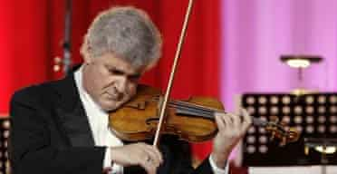 Violinist Pinchas Zuckerman plays a 250 year-old Guarnerius del Gesu violin during a concert in Pashkov House, Moscow
