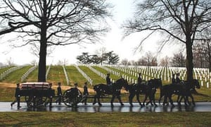 A horse drawn caisson carries the casket of Army Major Alan Greg Rogers to his burial service at Arlington national cemetery in Virginia