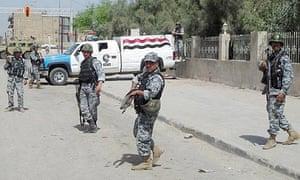 Iraqi policmen at a checkpoint in Basra, Iraq