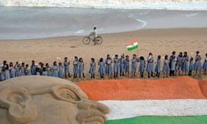A 60 feet long sand sculpture of an Indian national flag in Orissa