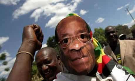 A man wears a Robert Mugabe mask in Harare