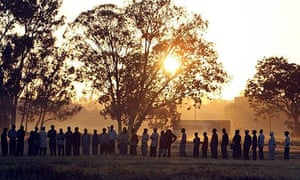 Hundreds of Zimbabwean wait in a voting queue on election day in Harare