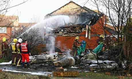 Fire crews attend the site of the aircraft crash in Farnborough, Kent