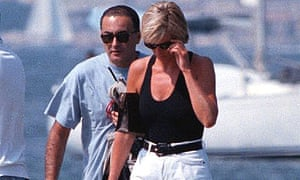 Diana, Princess of Wales, right, and her companion Dodi Fayed, walk on a pontoon in St. Tropez in this August 1997 file photo.