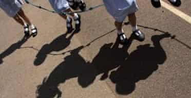 Schoolchildren skipping in the playground