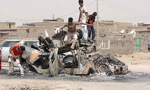 Iraqi children stand on top of a destroyed Iraqi army's vehicle in Basra.