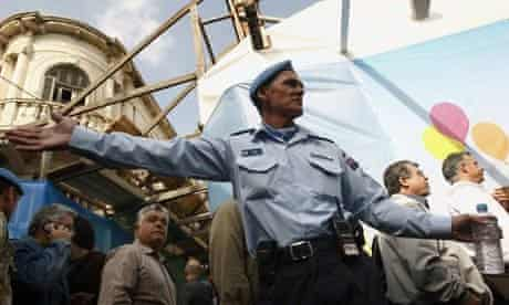A UN officer directs Cypriots in Nicosia