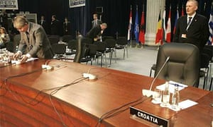 The position reserved for the Macedonian delegation at the Nato summit is left empty after the country's officials decided to leave the talks. Photograph: Michel Euler/AP