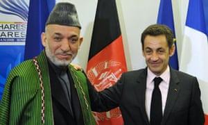 Nicolas Sarkozy with Hamid Karzai at the Nato summit in Bucharest where the French president announced he would send reinforcements to help the alliance's mission in Afghanistan.
