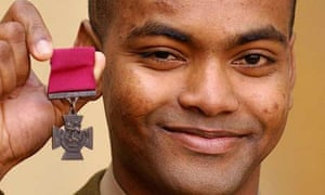 Private Johnson Beharry, who is from Grenada, with his Victoria Cross